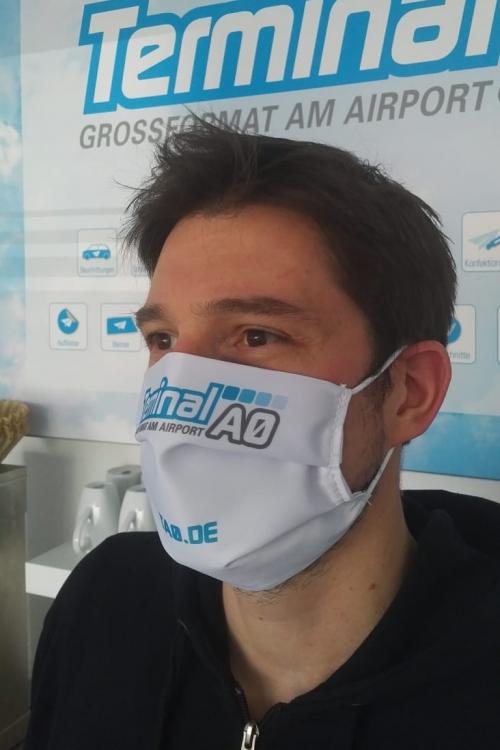 Es gibt auch individuell bedruckbare Masken. Foto: Terminal A0
